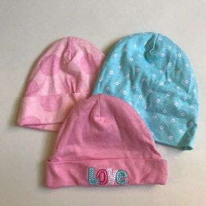 Pink and blue beanies